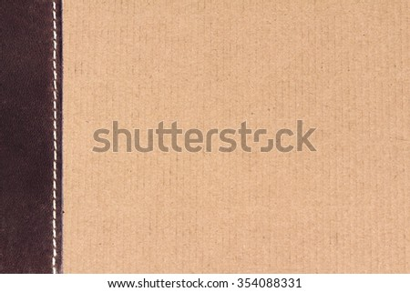 Background is made of cardboard and suture on suede. - stock photo