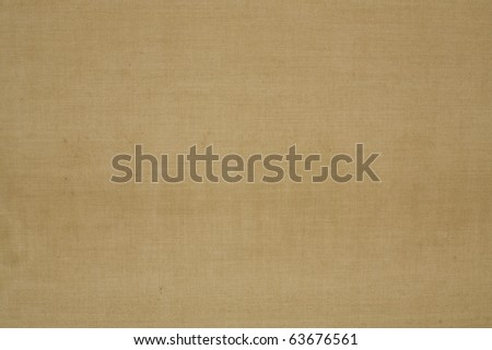 Background: Light brown canvas against sunlight close up