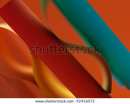 background macro image of colored origami pattern made of curved sheets of paper