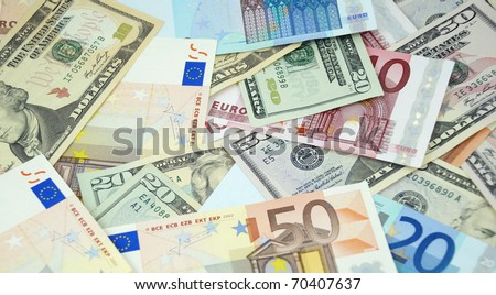 Background made from euro and dollar banknotes - stock photo