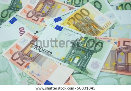 Background made from one hundred, two hundred and fifty euro banknotes - stock photo