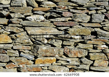 background made of a close-up of a stone wall - stock photo