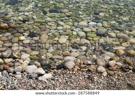 background made of a closeup of a pile of sea pebbles - stock photo