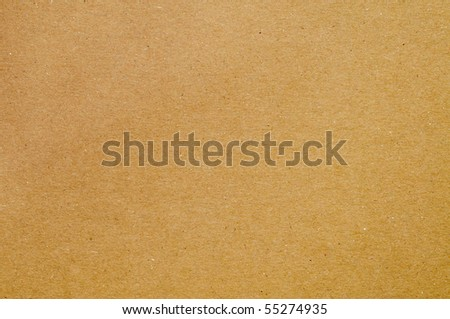 background made of a closeup of brown cardboard - stock photo