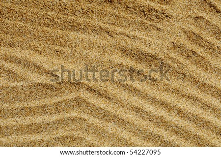 background made of a closeup of sand - stock photo