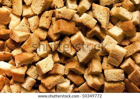 Background made of dice roasted bread (crispy croutons)