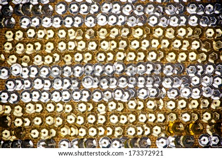 background made of golden and silver sequins fabric - stock photo