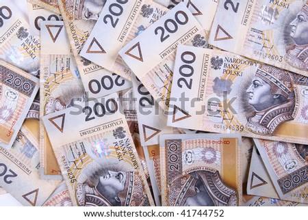 background made of polish 200 zloty banknotes - stock photo