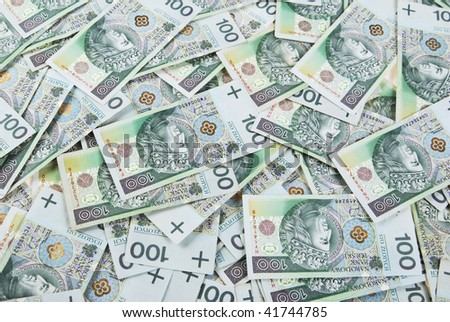 background made of polish 100 zloty banknotes - stock photo