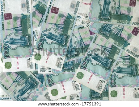 background made of russian one  thousand rubles banknotes - stock photo