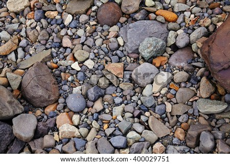 Background made of small and medium size stones - stock photo