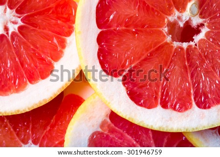 background made with a heap of sliced grapefruits - stock photo
