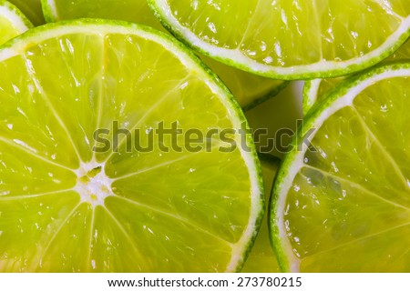 background made with a heap of sliced limes - stock photo