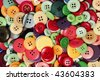 background made with a lot of colored buttons - stock photo