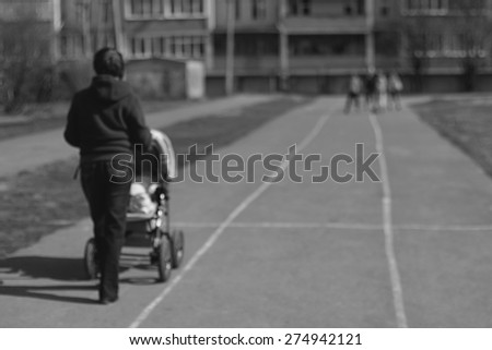 background Mom with stroller road rollers children - stock photo