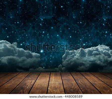 background night sky with stars, moon and clouds. wood floor. Elements of this image furnished by NASA - stock photo