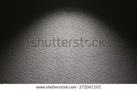 Background of a concrete wall and light spot. - stock photo