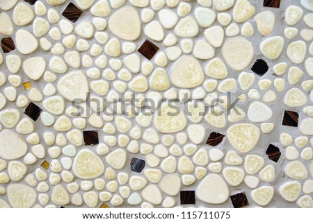 background of a floor with flat white stones in cement used in a bathroom, swimming pool and spa area's - stock photo