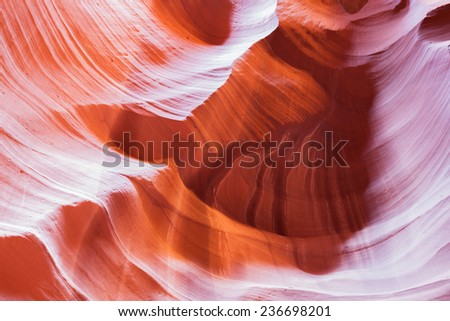 Background of a red and orange ancient sandstone wall carved by erosion in Upper Antelope Canyon located in Page, Arizona. - stock photo
