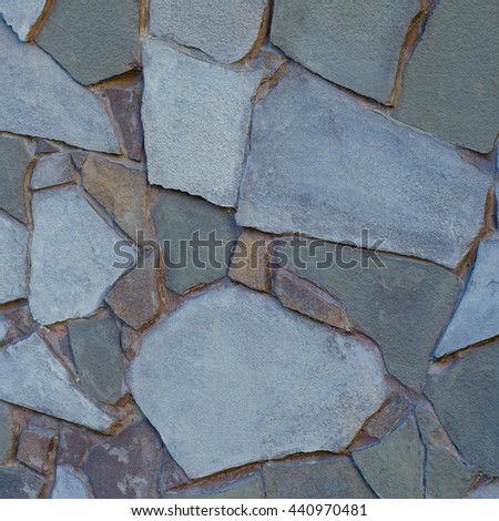 Background of a stone wall cladding texture, brown stone bricks  - stock photo
