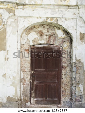background of a straight wooden door in a aslope wall