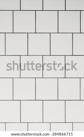 background of a tiled wall, white tiles with black grout - stock photo