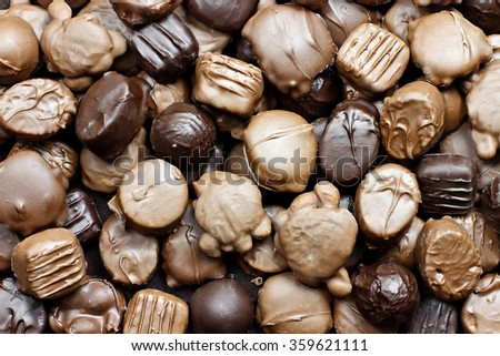 Background of a variety of milk and dark chocolate candies. - stock photo