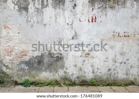 Background of a weathered old wall exposing brickwork - stock photo
