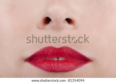 Background of a woman's nose and red lips - stock photo
