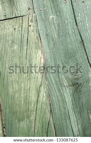Background of a wooden fence painted with green paint