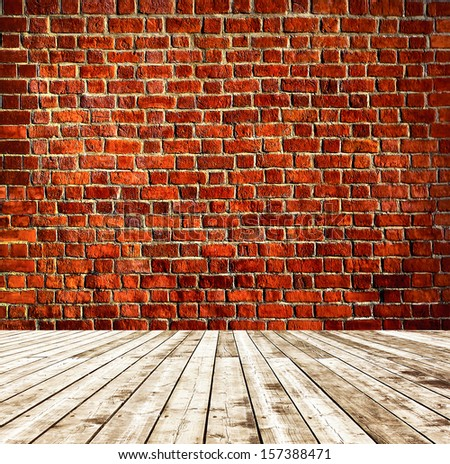 Background of aged grungy textured red orange brick and stone wall with light wooden floor with whiteboard inside old neglected and deserted empty interior, blank horizontal space of clean studio room - stock photo