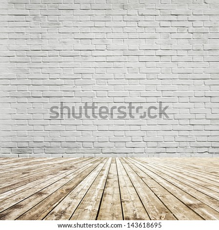 Background of aged grungy textured white brick and stone wall with light wooden floor with whiteboard inside old neglected and deserted empty interior, blank horizontal space of clean studio room - stock photo
