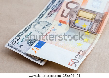 Background of American and European bills - stock photo