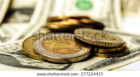 background of American dollars and coins