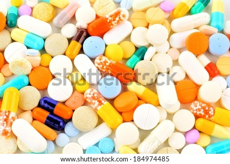 Background of an assortment of colorful medications - stock photo