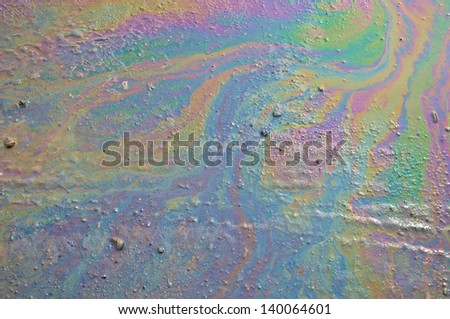 Background of an oil slick on the road. - stock photo