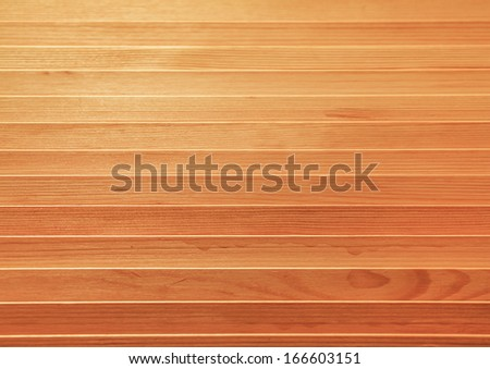Background of an old natural wooden darken room with messy and grungy cracked tree floor of beech texture inside vintage warm rural interior with soft shadows, dingy, dim light. Wood narrow boards. - stock photo