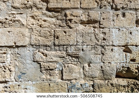 Background of ancient  brick wall. Texture of old amphitheater stone for design.