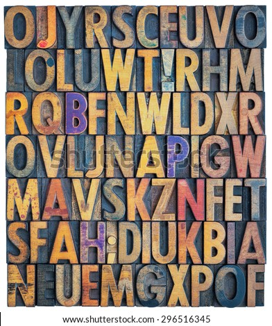 background of antique letterpress wood type printing blocks, random letters of alphabet and punctuation stained by color inks, isolated on white - stock photo