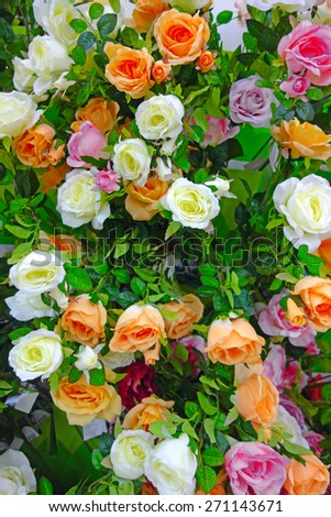Background of artificial roses made �¢??�¢??to the Orthodox Easter - stock photo