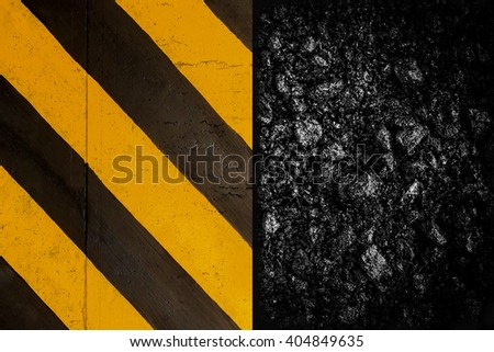 Background of asphalt under construction sign with yellow plate.