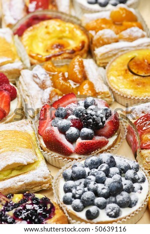 Background of assorted fresh sweet tarts and pastries - stock photo
