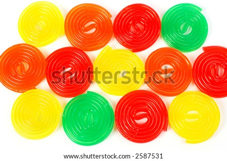 Background of assortment of multicolored licorices with                                                                    soft shadow - stock photo