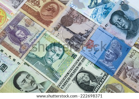 Background of banknotes from different countries - stock photo