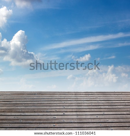 Background of beautiful blue sky and wooden deck - stock photo