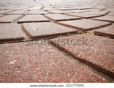 Background of beautiful granite paving slabs close up.  Focus on the foreground. - stock photo