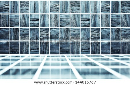 Background of beautiful modern luxury bathroom interior, blue glossy and clean ornamental stone tiled wall and floor in spacious domestic bath room and residential structure - stock photo