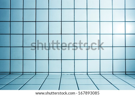 Background of beautiful modern turquoise luxury bathroom interior, blue glossy and clean ornamental stone tiled wall and floor in spacious domestic bath room and residential structure - stock photo