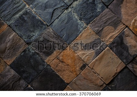 Background of black and brown stone tiles texture - stock photo