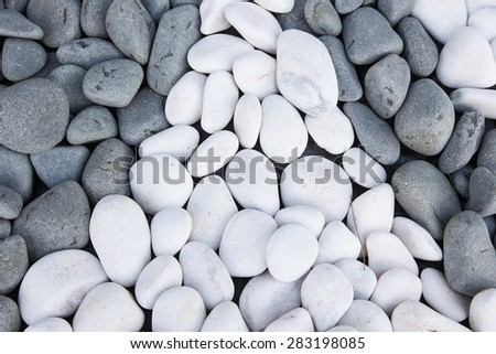 Background of black and white pebbles. - stock photo